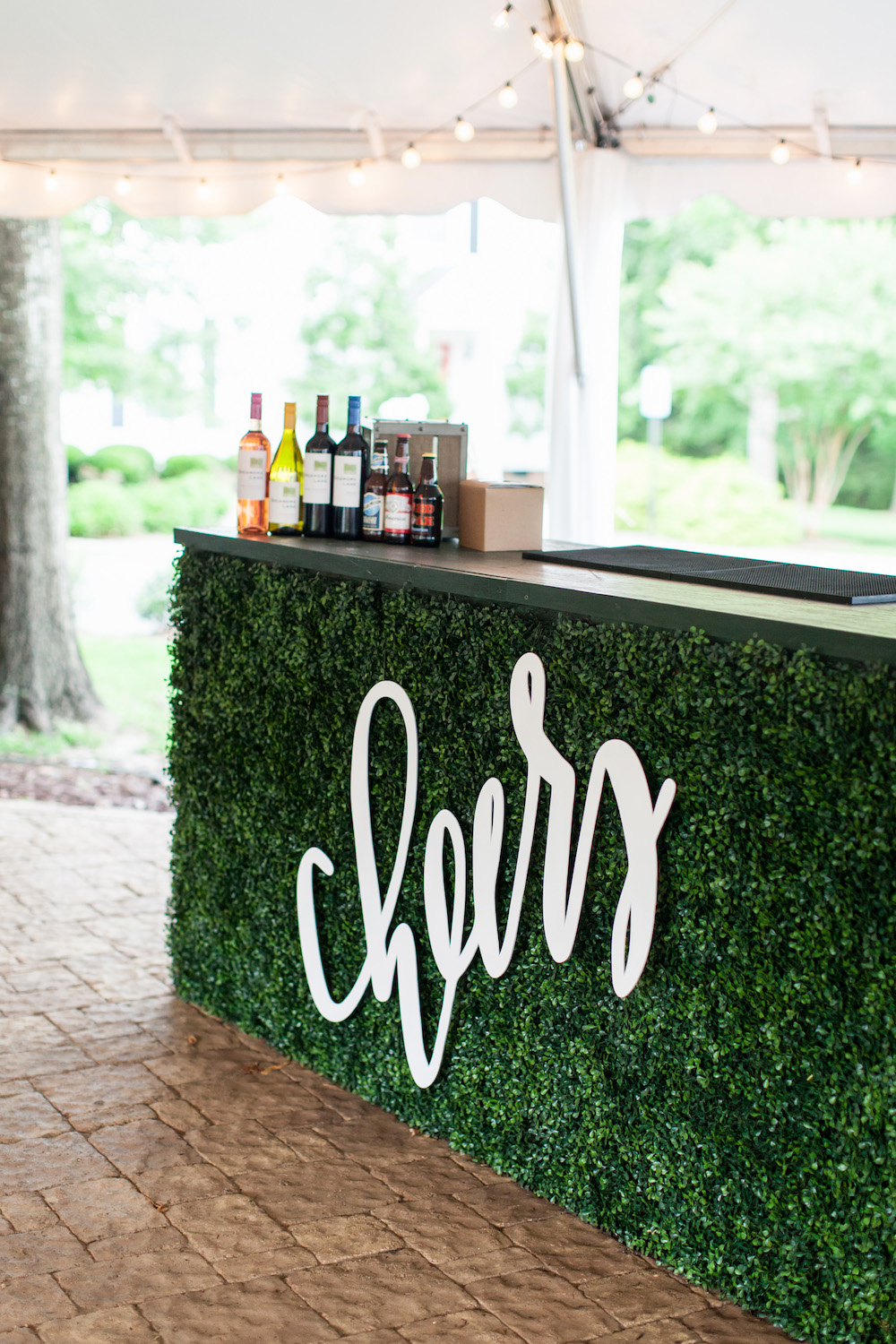 Wedding boxwood bar and cheers sign