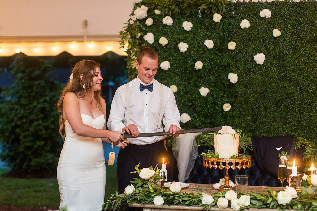 Wedding Cutting Cake With Sword