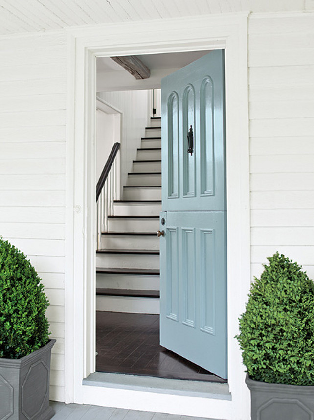 Blue front door and boxwoods
