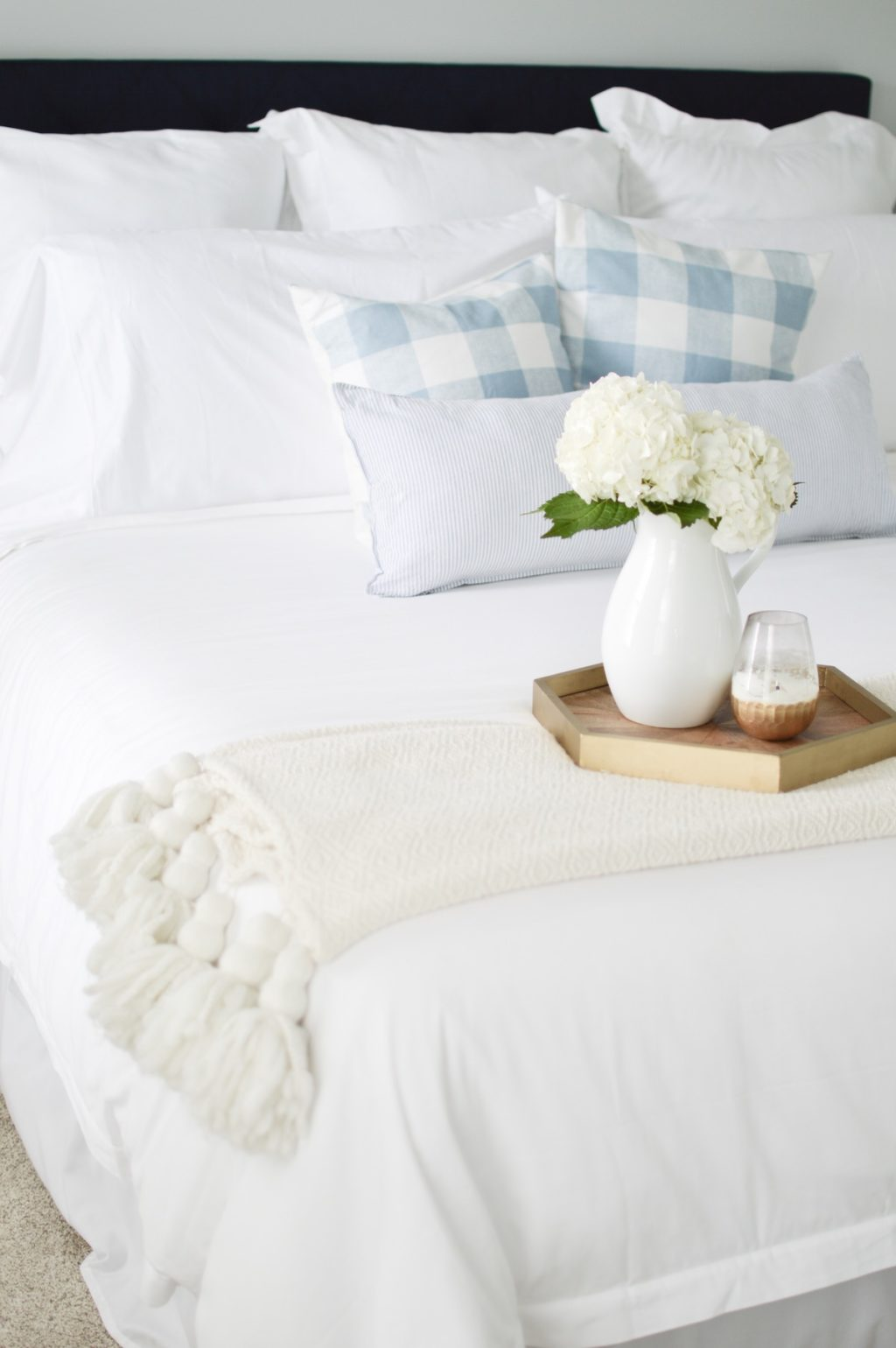 White and light blue bed